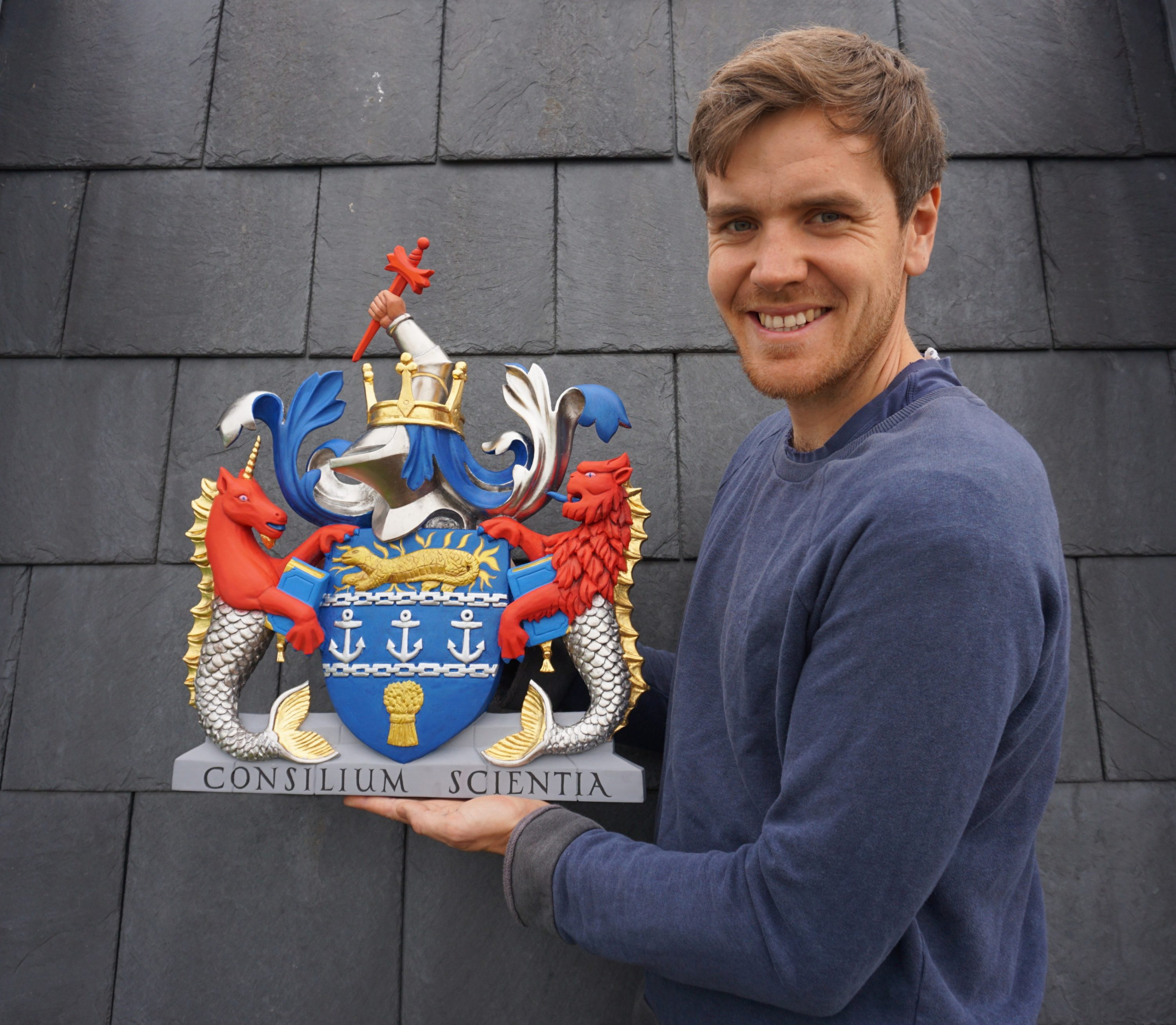 William Barsley holding the coat of arms
